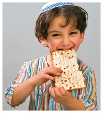 Young child eating matzah